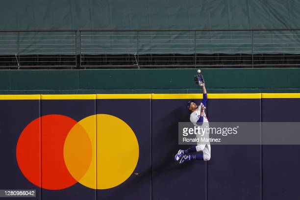 Mookie Betts of the Los Angeles Dodgers catches a fly ball at the wall on a hit by Freddie Freeman of the Atlanta Braves during the fifth inning in...