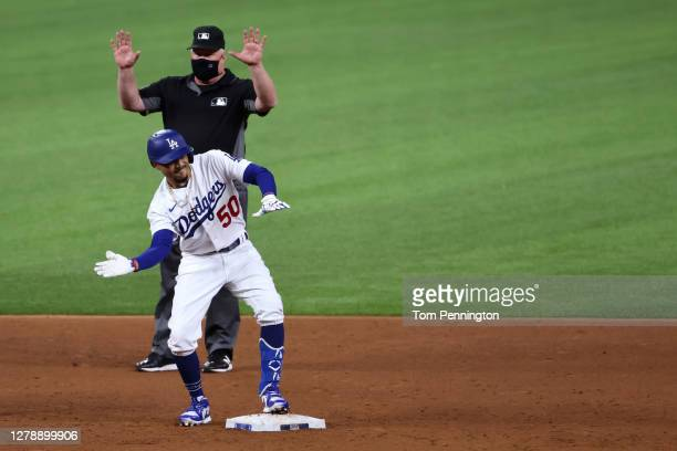 Mookie Betts of the Los Angeles Dodgers celebrates after hitting a double against the San Diego Padres during the sixth inning of Game One of the...