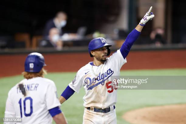 Mookie Betts of the Los Angeles Dodgers celebrates after hitting a solo home run against the Tampa Bay Rays during the sixth inning in Game One of...