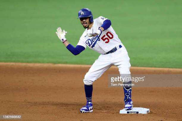 Mookie Betts of the Los Angeles Dodgers celebrates after hitting a double against the Tampa Bay Rays during the sixth inning in Game Six of the 2020...