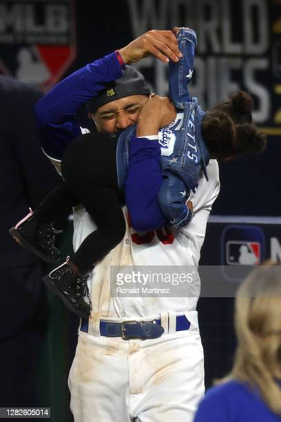 Mookie Betts of the Los Angeles Dodgers celebrates with his daughter Kynlee Ivory Betts after the teams 31 victory against the Tampa Bay Rays in Game...