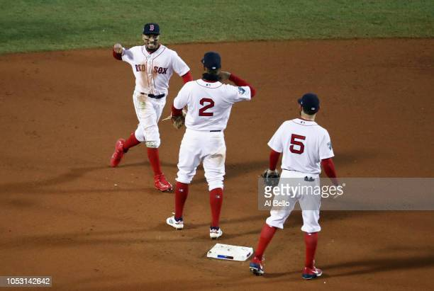 Mookie Betts Xander Bogaerts and Ian Kinsler of the Boston Red Sox celebrate their teams 42 win over the Los Angeles Dodgers in Game Two of the 2018...