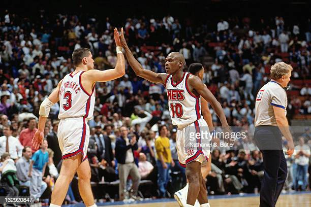 Mookie Blaylock and Drazen Petrovic of the New Jersey high five each other circa 1991 at the Brendan Byrne Arena in East Rutherford New Jersey NOTE...