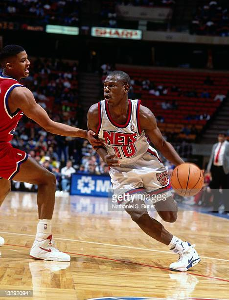Mookie Blaylock of the New Jersey Nets dribbles against the Washington Bullets circa 1991 at the Brendan Byrne Arena in East Rutherford New Jersey...