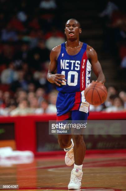 Mookie Blaylock of the New Jersey Nets dribbles upcourt against the Houston Rockets during an NBA game at the Summit circa 1990 in Houston Texas NOTE...