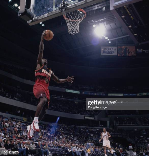 Mookie Blaylock, Point Guard for the Atlanta Hawks attempts a one handed lay up to the basket during the NBA Atlantic Division basketball game...