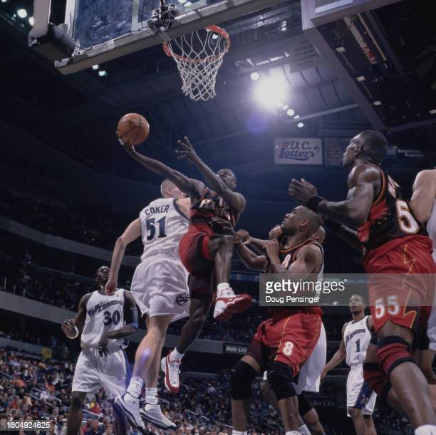 Mookie Blaylock, Point Guard for the Atlanta Hawks attempts to make a one handed lay up to the basket during the NBA Atlantic Division basketball...