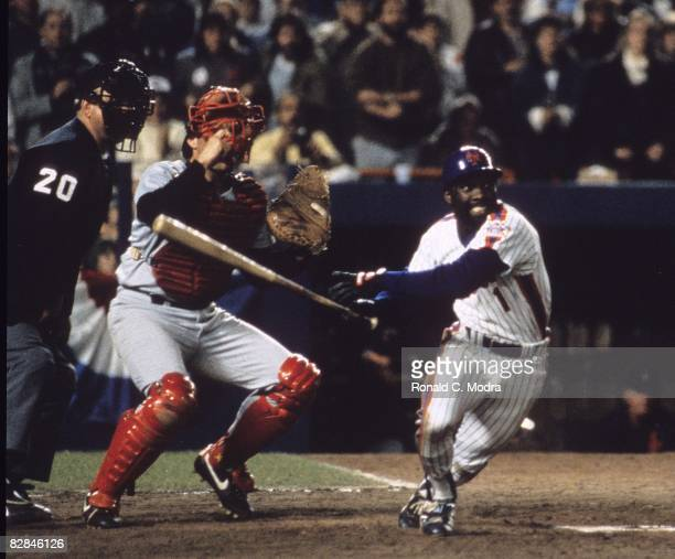 Mookie Wilson of the New York Mets bats during Game 7 of the 1986 World Series against the Boston Red Sox in Shea Stadium on October 27 1986 in...