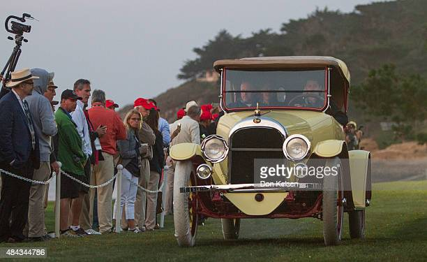 Moon 645 Roadster drives pre dawn Sunday morning onto the 18th green at The Lodge at Pebble Beach This annual ritual that has come to be known as...
