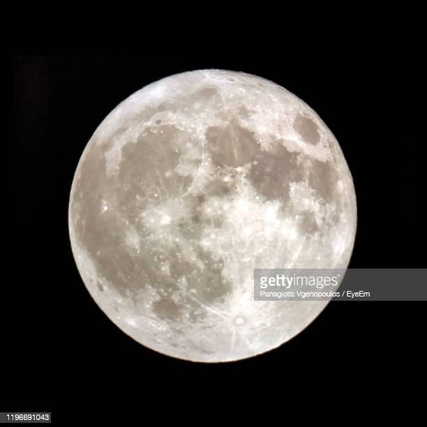 moon against sky at night - vgenopoulos stock pictures, royalty-free photos & images