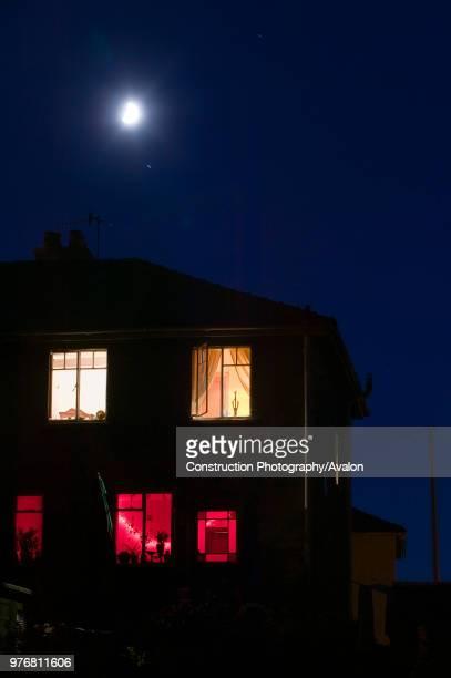 Moon and house at night Ambleside UK.