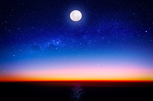 Moon and Milky Way on the beach - gettyimageskorea