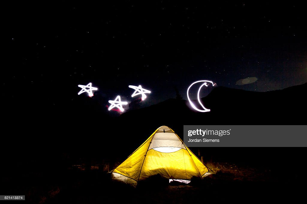 Moon and stars drawn with light over glowing tent  Stock Photo & Moon And Stars Drawn With Light Over Glowing Tent Stock Photo ...