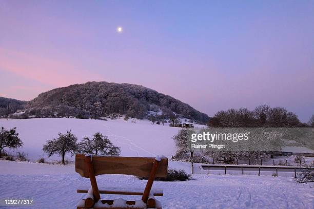 Moon bench and snowy hill in morning light