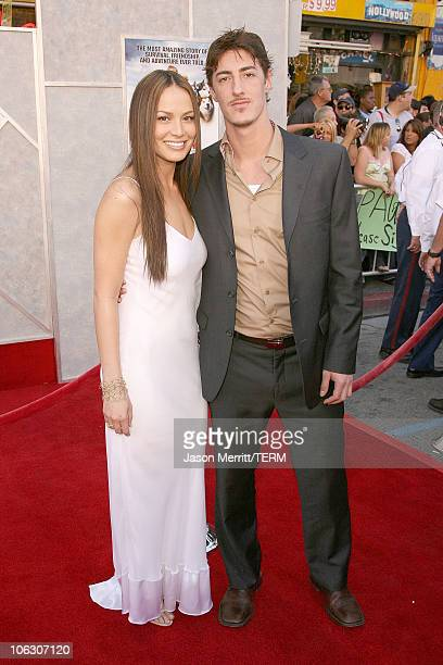 Moon Bloodgood and Eric Balfour during Eight Below Los Angeles Premiere Arrivals at El Capitan in Hollywood California United States