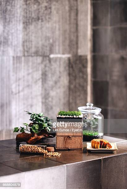 Moon Cake By Plant Decoration On Table At Home