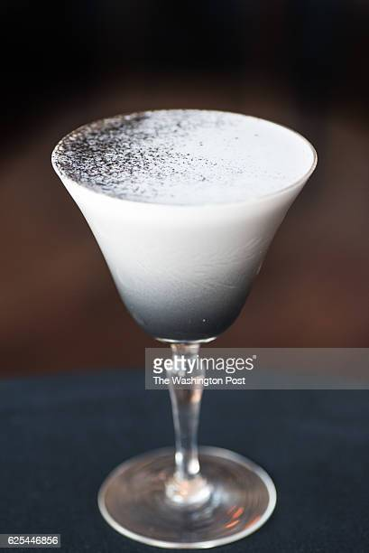 Moon Dance creme de violette lemon old tom gin and eggwhite with activated charcoal garnish at Himitsu