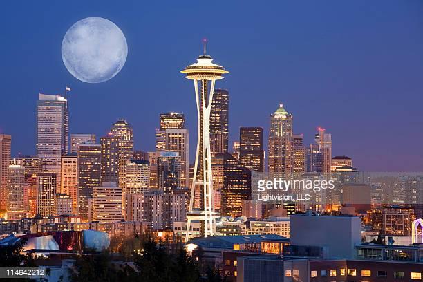 moon downtown skyline, seattle, washington - space needle stock-fotos und bilder