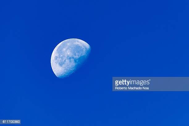 Moon in blue sky Last light of the moon in a blue sky