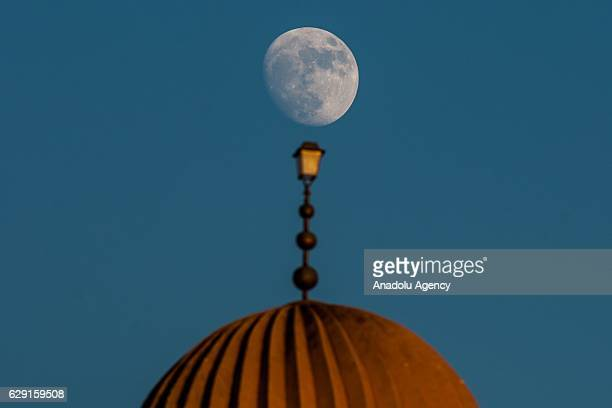 Moon is seen above the dome of the Great Mosque of Kairouan also known as the Mosque of Uqba during the celebrations for Mawlid alNabi the birth...