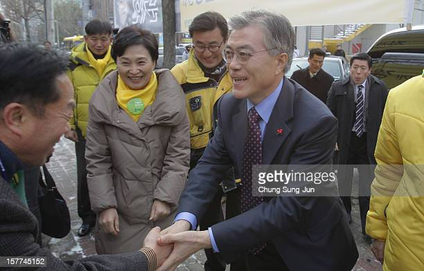 Moon Jae-In, presidential candidate of the main opposition Democratic United Party takes to downtown streets as he begins his presidential election...