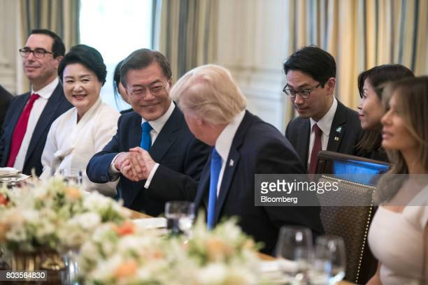 Moon Jaein South Korea's president center shakes hands with US President Donald Trump prior to dinner in the State Dinning Room at the White House in...