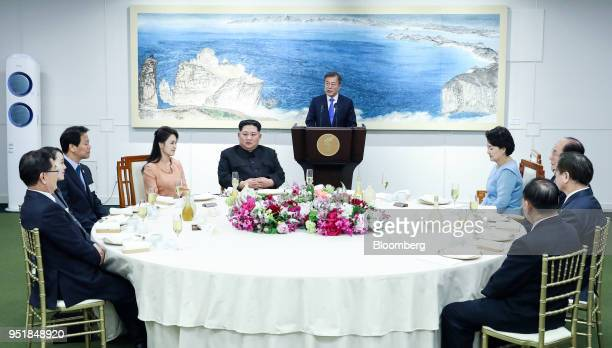 Moon Jaein South Korea's president center speaks as Ri Sol Ju North Korea's first lady fourth left Kim Jong Un North Korea's leader fifth left and...