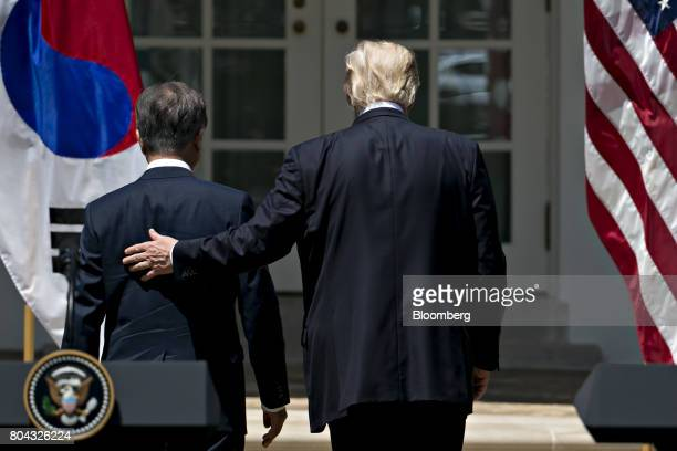 Moon Jaein South Korea's president left and US President Donald Trump walk away after a joint statement in the Rose Garden of the White House in...