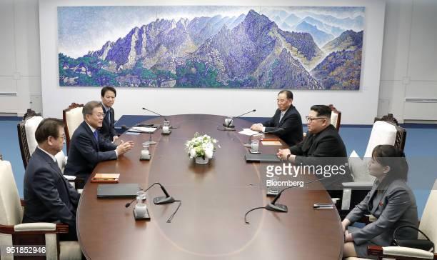 Moon Jaein South Korea's president left center Suhhoon South Korea's chief of the National Intelligence Service bottom left and Im Jongseok South...