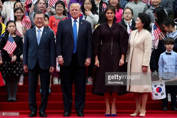 Moon Jaein South Korea's president left US President Donald Trump US First Lady Melania Trump and Kim Jungsook South Korea's first lady pose for a...