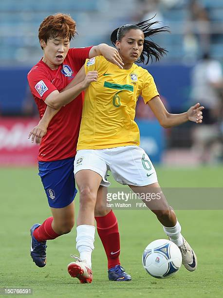 Moon Mira of Korea Republic tries to tackle Andressa of Brazil during the FIFA U20 Women's World Cup Japan 2012 Group B match between Korea Republic...