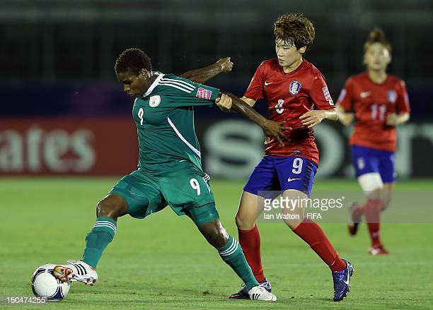 Moon Mira of Korean Republic tries to tackle Desire Oparanozie of Nigeria during the FIFA U-20 Women's World Cup Japan 2012, Group B match between...