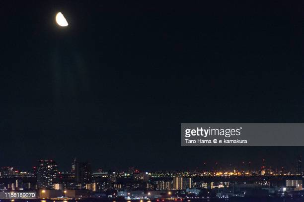 moon on illuminated residential district by the sea in kobe - region kinki stock-fotos und bilder