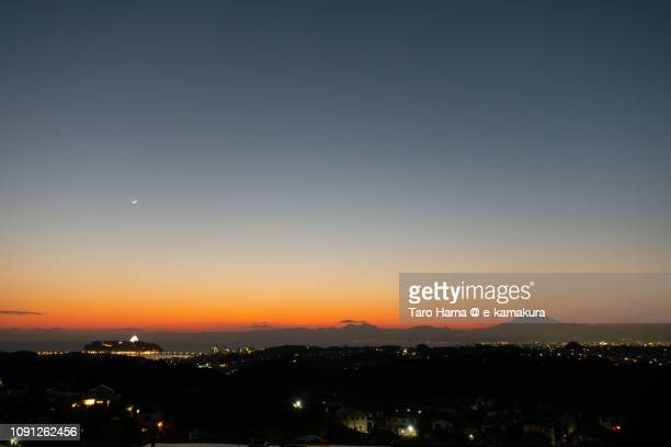 Moon on Mt. Fuji and Enoshima Island in Japan after the sunset