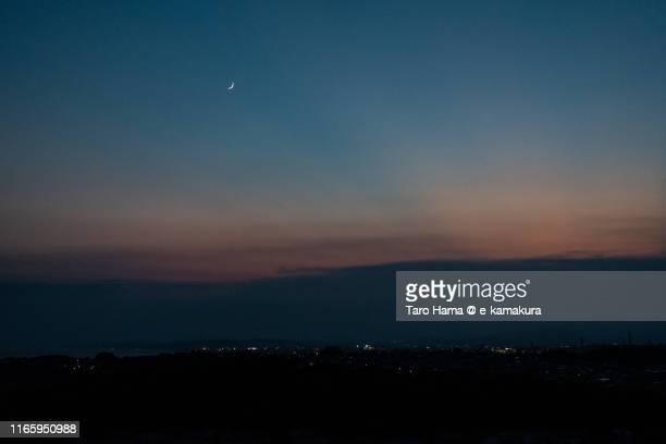 moon on the sunset land in japan - taro hama ストックフォトと画像