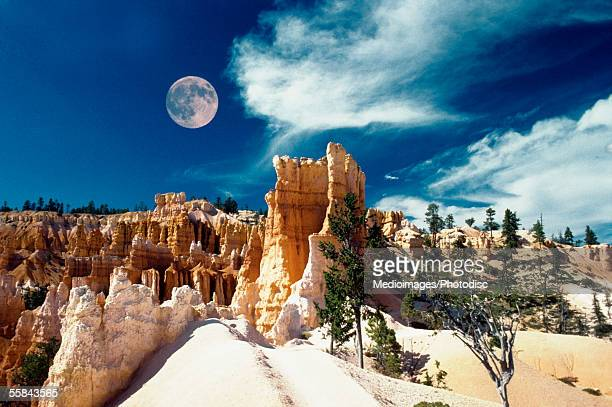 Moon over an arid landscape, Bryce Canyon National Park, Utah, USA