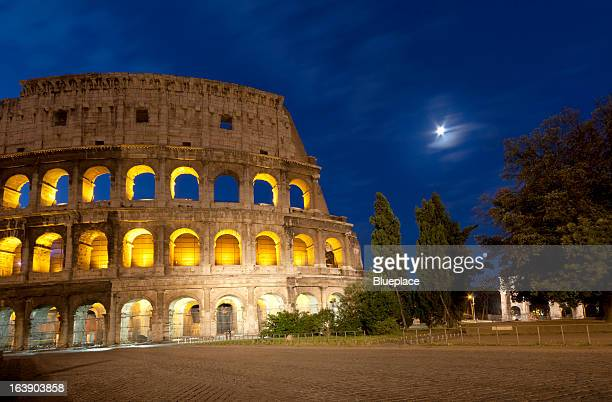 Moon over Colosseum. Rome, Italy