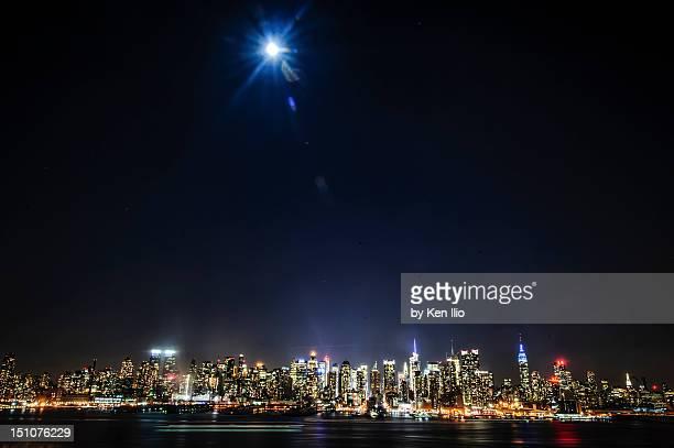 moon over manhattan - ken ilio stock photos and pictures