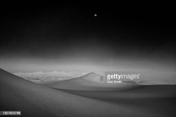 moon over mesquite dunes, death valley national park - don smith stock pictures, royalty-free photos & images