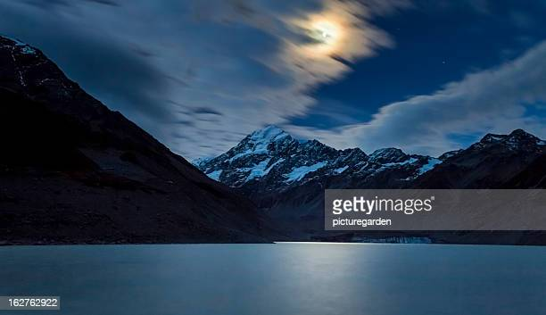 moon over mount cook - moonlight stock pictures, royalty-free photos & images
