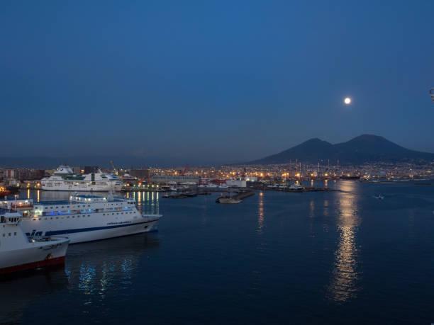 Moon over Mount Vesuvius. Port of Naples.