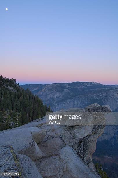 Moon over Overhanging Rock at First Light Glacier Point Yosemite National Park