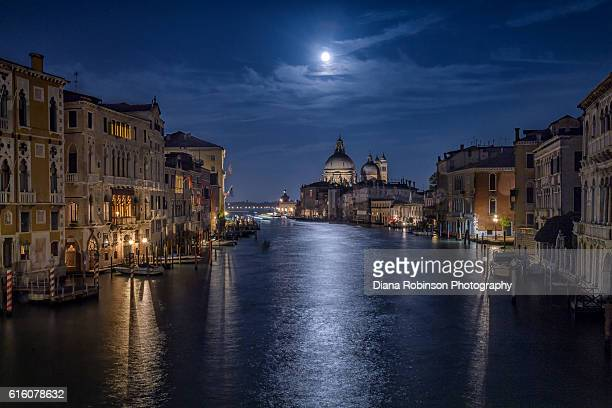 moon over santa maria della salute church from the accademia bridge, venice, italy - venezia foto e immagini stock