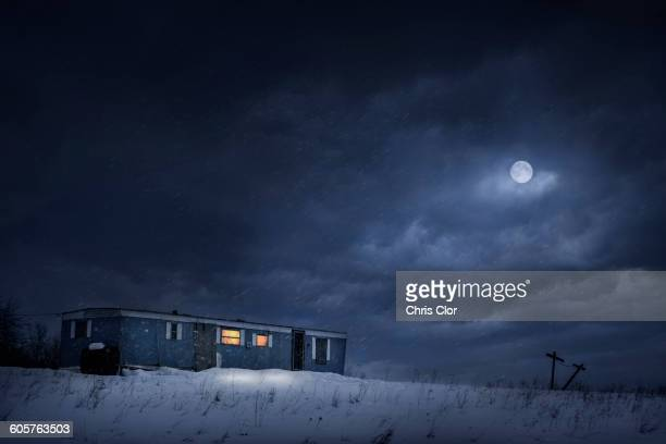 moon over trailer house in snowy yard - snow moon stock pictures, royalty-free photos & images