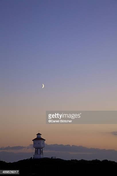 Moon over water tower