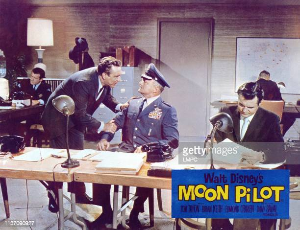 Moon Pilot, lobbycard, face to face from left: Edmond O'Brien, Brian Kieth, 1962.