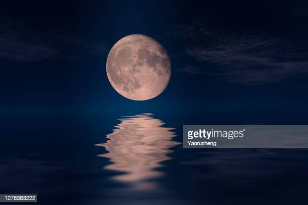 moon rise and reflection on the ocean - pacific ocean stock pictures, royalty-free photos & images