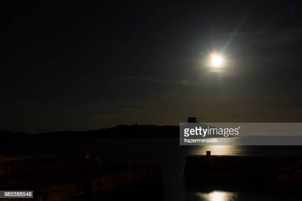 moon rise over dalkey island - dalkey stock pictures, royalty-free photos & images