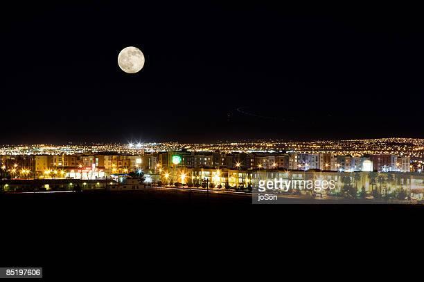 Moon rise over suburban housing neighbor at night