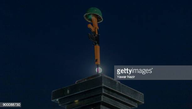 Moon rises above the war memorial during the wreath laying ceremony of Indian paramilitary troopers Killled in a gun battle with Kashmiri Muslim...